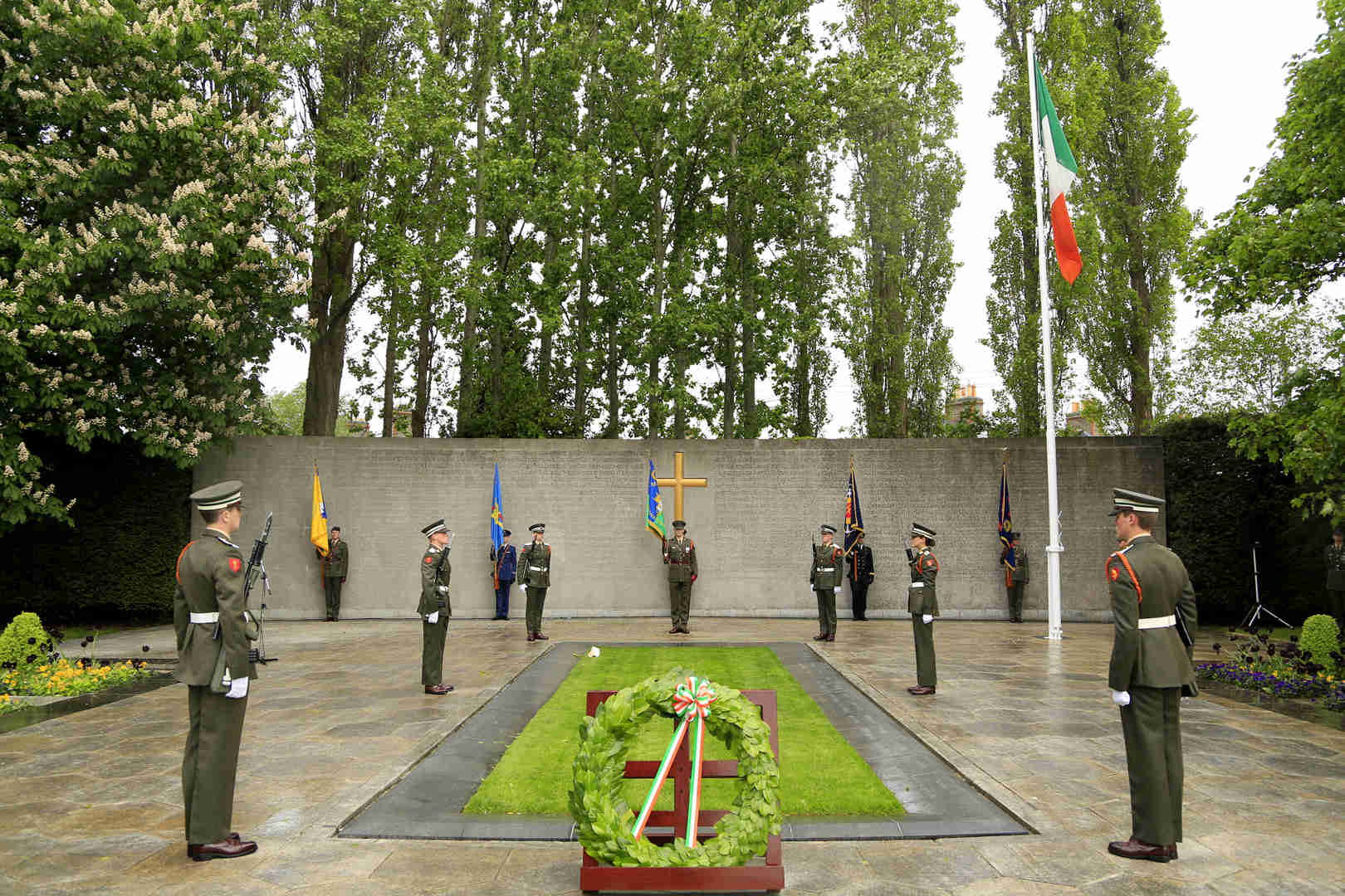 Defence Forces raising flag at Michael Collins memorial